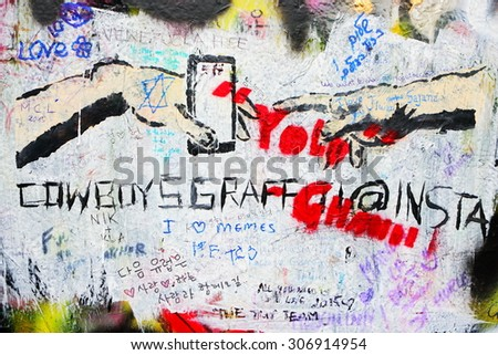 PRAGUE, CZECH REPUBLIC - FEBRUARY 24:The Lennon Wall since the 1980 filled with John Lennon-inspired graffiti and texts from Beatles songs on February 24, 2015 in Prague, Czech Republic - stock photo