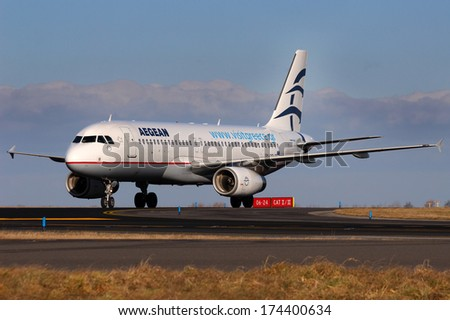 PRAGUE, CZECH REPUBLIC - JANUARY 12: Aegean Airlines Airbus A320-232 taxis to teminal at PRG Airport on January 12, 2014. Aegean Airlines  is the largest Greek airline. - stock photo