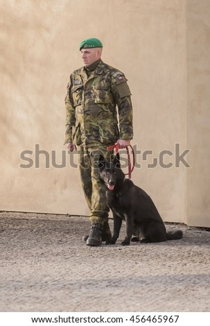 PRAGUE, CZECH REPUBLIC. January 26, 2015. Czech policeman with a dog outside the president's palace. Editorial image.