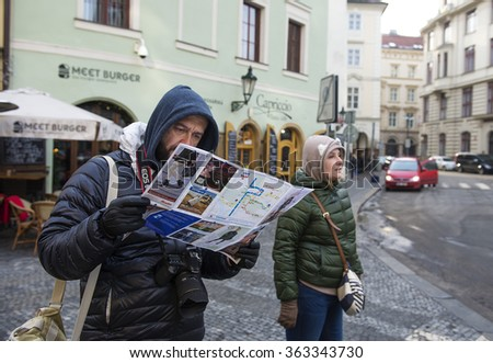 Prague,Czech Republic - January 11, 2016 :  Lost tourists view the city map