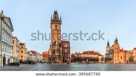 Prague, Czech Republic - January 16, 2015: Panorama of the Old Town Square with Old Town Hall Clock Tower in the center and people walking in the street - stock photo