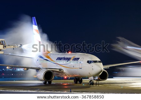 PRAGUE, CZECH REPUBLIC - JANUARY 21: Smart Wings Boeing 737-7Q8 during de-icing at PRG Airport on January 21, 2016.Smart Wings is a brand of the Czech Travel Service Airlines. - stock photo