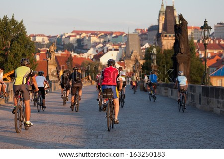 PRAGUE, CZECH REPUBLIC - JULE 28: Cyclists on Charles Bridge, Jule 30, 2013, Prague,Czech Republic. Annually Prague is visited by more than 3,5 million tourists