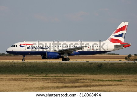 PRAGUE, CZECH REPUBLIC - JULY 31: British Airways Airbus A320-232 lands at PRG Airport on July 31, 2015. British Airways is the flag carrier airline of the United Kingdom. - stock photo