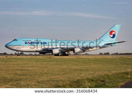 PRAGUE, CZECH REPUBLIC - JULY 31: Korean Air Boeing 747-4B5 lands at PRG Airport on July 31, 2015. Korean Air  is the largest airline in South Korea. - stock photo
