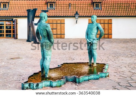PRAGUE, CZECH REPUBLIC - JULY 17, 2012: Peeing Statues, by Czech Sculptor David Cerny beside to the Museum of Franz Kafka in the yard of Hergetova Cihelna.  - stock photo