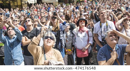 Prague,Czech Republic - July 6, 2016 :  Tourists stearing at Astronomical Clock on the Old Town Square.As every summer the capital city is full of visitors.