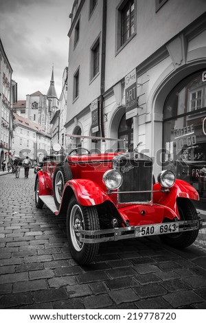 PRAGUE, CZECH REPUBLIC - 21 JUNE 2014 - Famous historic red car Praga in Prague street. Praga is a manufacturing company founded in 1907 based in Prague, Czech Republic.  - stock photo