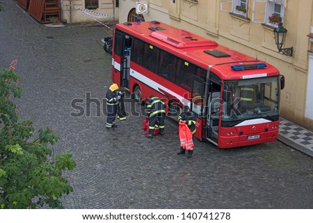 PRAGUE, CZECH REPUBLIC - JUNE 2: Fire brigade setting up bus to serve as head quarters in the flooded Malastrana district, Prague, on June 2, 2013 in Prague, Czech Republic