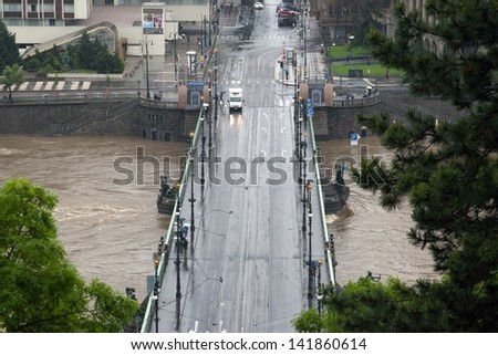 Prague, Czech Republic - June 3: Massive Rain Caused Floods in Czech Capital City on june 3, 2013. Rising Vltava River Forced Many People to be Evacuated. - stock photo