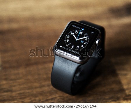 PRAGUE, CZECH REPUBLIC - June 22, 2015: New wearable Apple Watch smartwatch displaying the Home screen. Apple Watch has fitness tracking and health-oriented capabilities with iOS products. - stock photo