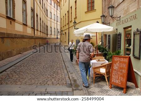 PRAGUE, CZECH REPUBLIC - JUNE 06, 2008: Old cobbled street in the city of Prague in Czech Republic - stock photo