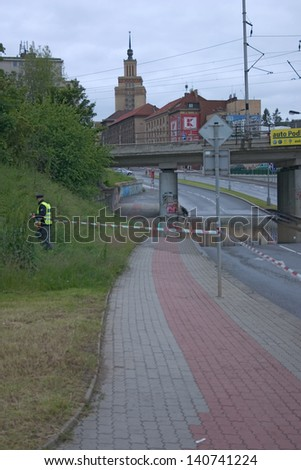 PRAGUE, CZECH REPUBLIC - JUNE 2: Policemen cordoning road off in Prague, Dejvice, because of the flooding the, on June 2, 2013 in Prague, Czech Republic