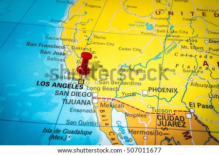 PRAGUE, CZECH REPUBLIC - JUNE 27, 2015: Red thumbtack in a map, pushpin pointing at Los Angeles city