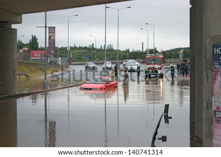 PRAGUE, CZECH REPUBLIC - JUNE 2: Stranded car in flooded road, under bridge, because of the flooding, fire brigade rescuing it on June 2, 2013 in Prague, Czech Republic - stock photo