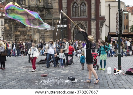 PRAGUE, CZECH REPUBLIC - JUNE 6, 2013: Street Artist of the Old Town Square in Prague blowing bubbles