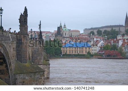 PRAGUE, CZECH REPUBLIC - JUNE 2: Swollen Vltava river with Charles Bridge, on June 2, 2013 in Prague, Czech Republic - stock photo