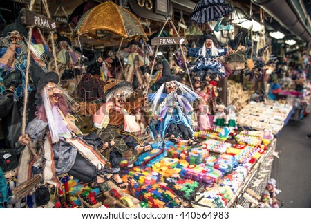 Prague, Czech Republic - June 21, 2016: Toy Puppet Witches on outdoor Market stall in the Old Town of Prague.