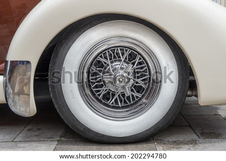 PRAGUE, CZECH REPUBLIC - JUNE 21, 2014: Vintage tire on the Auburn 851 Supercharged speedster. Auburn Speedster was an American car produced in Auburn, Indiana from 1925 through 1937 - stock photo