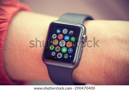 PRAGUE, CZECH REPUBLIC - June 22, 2015: Woman Using App on Apple Watch outside. Multiple Apps View. - stock photo