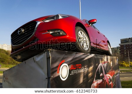 PRAGUE, CZECH REPUBLIC - MARCH 31: Mazda 3 car in front of dealership building on March 31, 2017 in Prague, Czech republic. Mazda set to launch new electric vehicle range by 2019.