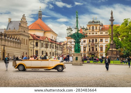 Prague, Czech Republic - May 23, 2015: And old timer car driving through Hradcany square  - stock photo