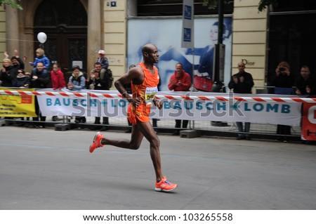 PRAGUE, CZECH REPUBLIC - MAY 13: Ethiopian Deressa Chimsa runs for victory in the Prague International Marathon (PIM), May 13, 2012 in Prague, Czech republic. - stock photo