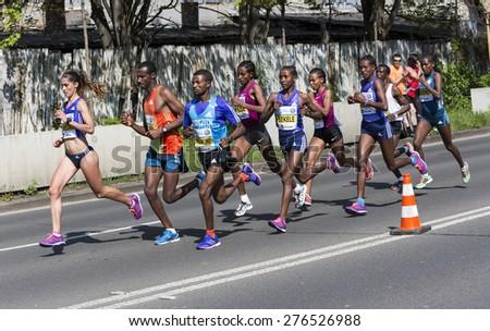 PRAGUE, CZECH REPUBLIC - 3 MAY 2015: Group of runners runs the Volkswagen Prague Marathon, Czech republic. The world's top marathon runners in the lead - stock photo