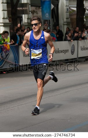 PRAGUE, CZECH REPUBLIC - MAY 3, 2015: Jiri Homolac, the  Czech silver medalist of  the Volkswagen Prague Marathon 2015 (out of Czech participants only) running his last 100 m to Old Town Square finish - stock photo