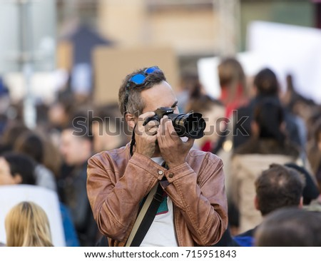 PRAGUE, CZECH REPUBLIC - MAY 15, 2017: Man taking photos of demonstration on Prague Wenceslas square against the current government and Babis, the finance minister.