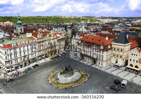 PRAGUE, CZECH REPUBLIC - MAY 2015: Prague Old Town Square with the view over Jan Hus Monument, Goltz-Kinsky Palace, House of  Stone Bell and other baroque buildings