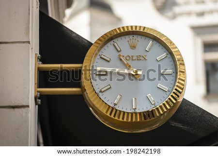 PRAGUE, CZECH REPUBLIC - MAY 23, 2014: Rolex outdoor analog clock on the wall in Prague. - stock photo