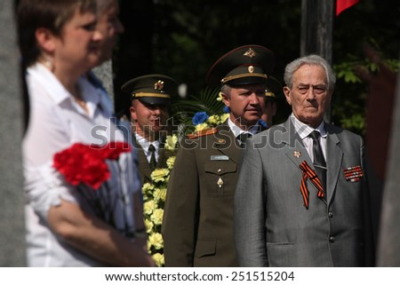 PRAGUE, CZECH REPUBLIC - MAY 9, 2013: Soviet war veterans attend the celebration of Victory Day at the Soviet War Memorial at the Olsany Cemetery in Prague, Czech Republic. - stock photo