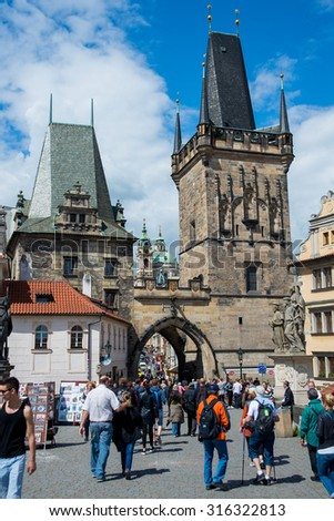 PRAGUE, CZECH REPUBLIC - MAY 6, 2015: The popular tourist itinerary in Prague on the Charles Bridge. May 6, 2015. Prague, Czech Republic.
