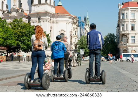 PRAGUE, CZECH REPUBLIC - MAY 20, 2014: Tourists at the Old Town Square during their guided Segway tour  - stock photo