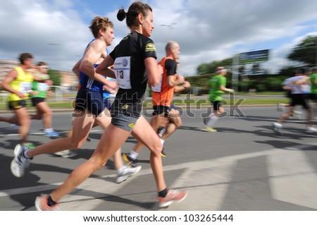 PRAGUE, CZECH REPUBLIC - MAY 13: Unidentified runners participate in the Prague International Marathon (PIM), May 13, 2012 in Prague, Czech republic. - stock photo