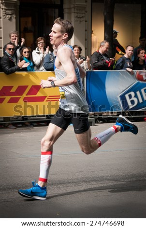 PRAGUE, CZECH REPUBLIC - MAY 3, 2015: Vit Pavlista, the  Czech winner of  the Volkswagen Prague Marathon 2015 (out of Czech participants only) running his last 100 m to the Old Town Square finish - stock photo