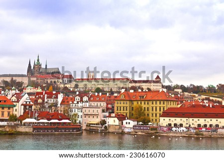 PRAGUE, CZECH REPUBLIC - NOVEMBER 10, 2014:  A view from the river of the Prague Castle which dates back to the ninth century and is the largest ancient castle in the world. - stock photo