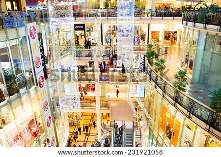PRAGUE, CZECH REPUBLIC - NOVEMBER 18, 2014: Palladium shopping mall with Christmas decorations. Palladium is a shopping mall located in  Prague. The mall contains 170 shops and 30 restaurants. - stock photo