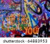 PRAGUE, CZECH REPUBLIC - OCTOBER 21: The Lennon Wall since the 1980s filled with John Lennon-inspired graffiti and pieces of lyrics from Beatles songs on October 21, 2010 in Prague, Czech Republic - stock photo