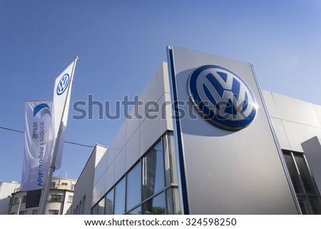 PRAGUE, CZECH REPUBLIC - OCTOBER 1: Volkswagen car maker logo on a building of dealership on October 1, 2015 in Prague, Czech republic. - stock photo