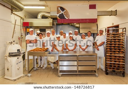PRAGUE, CZECH REPUBLIC - SEPTEMBER 4, 2012: An unidentified group of bakers team at the working place on September 4, 2012.