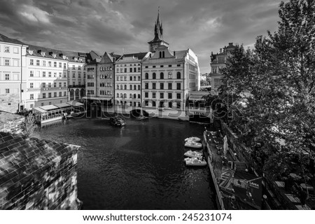PRAGUE, CZECH REPUBLIC - SEPTEMBER 19, 2014: Beautiful old houses on the banks of the Vltava. Black and white. Prague is the capital and largest city of the Czech Republic.