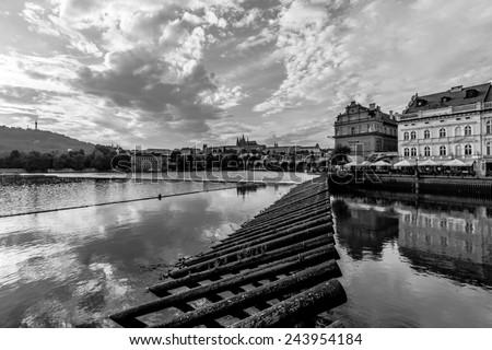 PRAGUE, CZECH REPUBLIC - SEPTEMBER 19, 2014: Charles Bridge and the Vltava River. Black and white. The Charles Bridge is a famous historic bridge that crosses the Vltava river in Prague. - stock photo