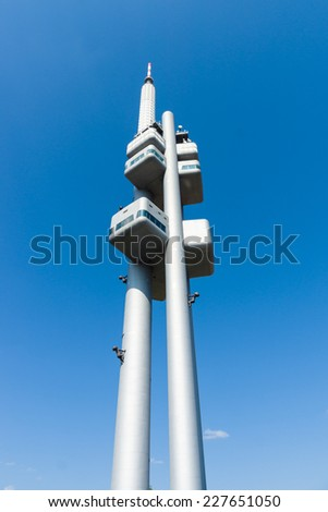 PRAGUE, CZECH REPUBLIC - SEPTEMBER 04, 2014: Famous Prague Zizkov Television Tower (216 metres). The tower is an example of high-tech architecture - stock photo