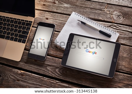 PRAGUE, CZECH REPUBLIC - SEPTEMBER 1, 2015: New Google logo on their search page immediately at the release date is displayed on iphone 6 plus and ipad mini. With clipping paths. - stock photo