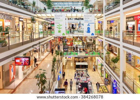 PRAGUE, CZECH REPUBLIC - SEPTEMBER 23, 2015: Palac Flora shopping center interior. Opened in 2003, contains 4 floors, 120 shops, Cinema City & IMAX theater and is one of the largest malls in Prague. - stock photo