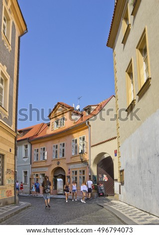 PRAGUE, CZECH REPUBLIC   - SEPTEMBER 13, 2016: Small street in Mala Strana district with colorful buildings and sightseeing people