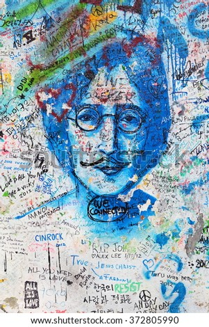 PRAGUE, CZECH REPUBLIC - SEPTEMBER 30: The Lennon Wall since the 1980s is filled with John Lennon-inspired graffiti and pieces of lyrics from Beatles songs on Sep 30, 2014 in Prague, Czech Republic - stock photo