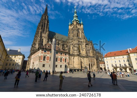 PRAGUE, CZECH REPUBLIC - SEPTEMBER 19, 2014: The Metropolitan Cathedral of Saints Vitus, Wenceslaus and Adalbert. The cathedral is an excellent example of Gothic architecture. - stock photo